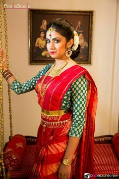 South Indian bride. Temple jewelry. Jhumkis.Red silk kanchipuram sari with contrast long sleeve green blouse.Braid with fresh jasmine flowers. Tamil bride. Telugu bride. Kannada bride. Hindu bride. Malayalee bride.Kerala bride.South Indian wedding