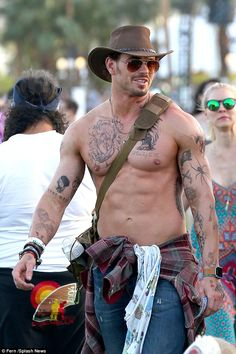 Kellan Lutz stripped off his shirt on day one of the annual Coachella music festival in Indio, California on Friday The Twilight star wasn't shy about flaunting his tanned physique and his collection of fake tattoos