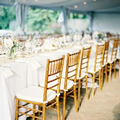 Wooden chiavari chairs, crisp white linens and burlap runners created a natural look at the reception.  Like the long tables.