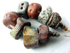 8 Artisan chunky Ceramic  Beads Contemporary gold rust patina orange red black painterly.  via Etsy.