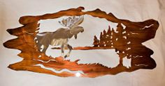 """Tree Log Moose Wall Hanging by Colorado Custom Metal. $174.99. Indoor and Outdoor display. Made in Colorado. Beautiful yet durable powder coated finish. Intricately cut from 14 gauge steel. 42"""" x 20"""". This 42 inch by 20 inch Tree Log Moose wall hanging is cut from 14 gauge steel sheet metal. Each has a powder coated finish to prevent scratching and fading, making it perfect for indoor and outdoor display. Made upon order in Colorado."""