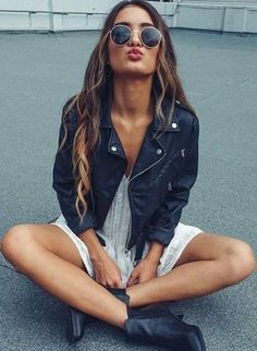 moto jacket. round sunglasses. white lace dress. ankle boots.
