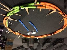 Large crown of thorns made from pool noodles. Gives a description of how they did it.