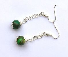 A personal favorite from my Etsy shop https://www.etsy.com/listing/279436664/modern-style-beaded-earrings-emerald