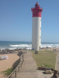 Umhlanga Lighthouse just north of Durban Photography 101, Cn Tower, Playground, Lighthouse, Tropical, Ocean, City, Building, Beach