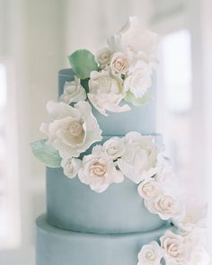 Pale blue wedding cake adorned with sugar flowers #weddingcake #cake #wedding #weddingcakes