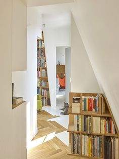 Books dominate the space in this small apartment located in Paris. The 753 square feet apartment was completely renovated, opening the space and making place to the owner's extensive book col