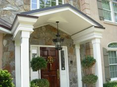 Interior, : Fancy Front Porch Portico Decoration With Stone Exterior Wall Design Including Vintage Black Metal Ceiling Lamp And Solid Wood Single Front Door
