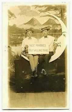 Vintage Paper Moon portrait with two men holding a sign, Not Married But Willing to Be