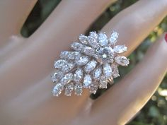 18k Platinum Pear shaped Diamond cluster ring with central round brilliant cut and surrounded by marquise diamonds