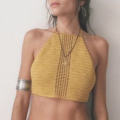 This stunning mustard crochet crop top can take you from the festival to the beach.