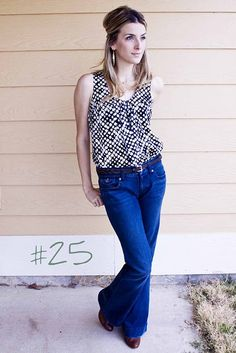 Love the wide leg jeans with the tucked blouse.
