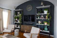 This faded black wall gives the room depth and accents the unique curved ceiling!