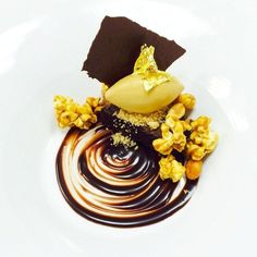 Special dessert for tonight!! Chocolate brownie, caramel ice cream, candied popcorn and peanuts brittle #theartofplating #chefstalk | by Pastry Chef Antonio Bachour #Plateddesserts