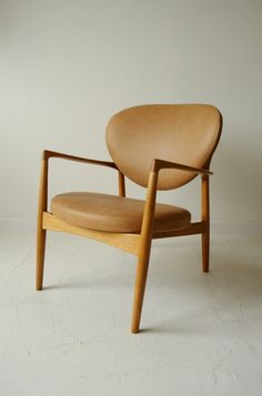 Ib Kofod Larsen; Beech and Leather Easy Chair, 1950s.