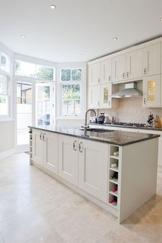 Simple, light and bright - with granite worktops (or equivalent but similar effect) and limestone flooring