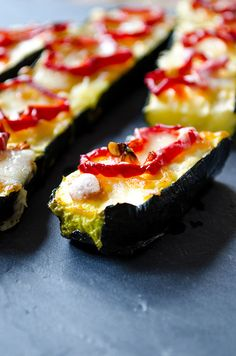 The easiest baked zucchini topped with cheese and red bell pepper rings. A perfect way to use summer zucchini! Pair it with green lentil pasta if you are vegetarian or with chicken if you are not. | giverecipe.com | #zucchini #vegetarian #summer #glutenfree #healthy #easyrecipe #lowcarb