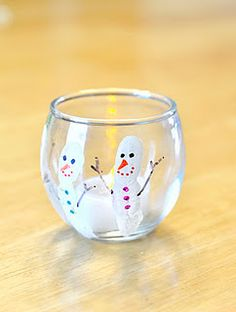 Fingerprint Snowman Candle Holder 1) Paint your child's index finger with white paint. Carefully press onto the votive holder. Repeat as many times as desired. Allow to dry. 2) Use permanent markers to add eyes, nose, mouth, buttons, arms, etc. to your snowman (or woman). 3) Add a tea-light candle.