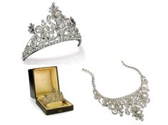 Antique silver and gold tiara with old-cut diamonds in a scroll and stylized flower design. Can be worn as a necklace with two additional elements in gold and silver. Second half 19th century.  In original box.