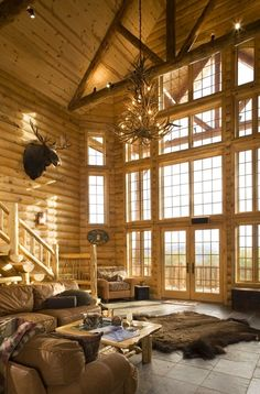 When I retire I want to live in a log home. The bright wood and open windows makes me happy!!! Bebe'!!! This log home is both modern and efficient but still maintains the coziness and  warmth of a log home!!!