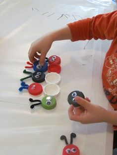 Bugs on the sticky table...definitely a activity to create with all those lids I have hanging around!