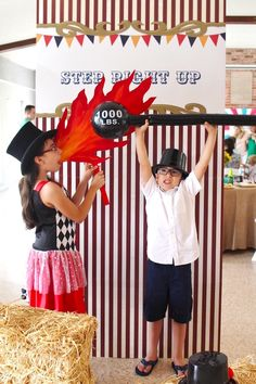 Photo op station with adorable props inside a Big Top Circus Birthday Party at…