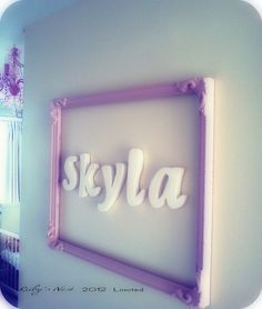 Add some charm to the kids bedroom doors with a painted vintage frame and funky wooden letters.    Super cute!