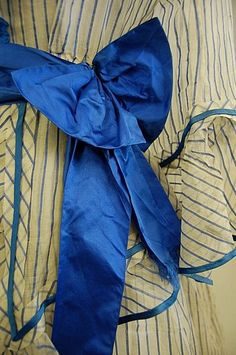A blue and white striped gauze summer gown, circa the bodice with square neckline, flounced sleeves, peplum trimmed with blue satin, blue ribbon belt with later added bow. Historical Costume, Historical Clothing, French Fashion, Vintage Fashion, Summer Gowns, Old Dresses, Period Outfit, Dressed To The Nines, Period Costumes