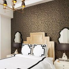 art deco gold headboard, black and white greek key duvet, mirrors over nightstands, bungalow 5 nightstands, black mirrors, antique brass chandelier, gold and black chandelier, foo dog lamps, white foo dog lamps, black lamp shades, Graham & Brown Illusion Wallpaper,