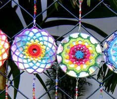 They are upcycled CDs that have colorful #crochet mandalas over them and then are hung in strings. By Cristina Vasconcellos.
