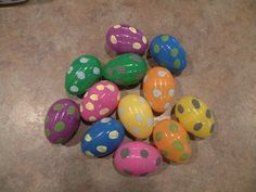 """First set of """"Dino"""" eggs. These are just larger plastic eggs and I painted the dots on them. Going to use as a dino egg hunt."""
