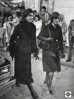Jackie, with half-sister Janet Rutherford, at the funeral of Jackie's stepfather, Hugh D. Auchincloss
