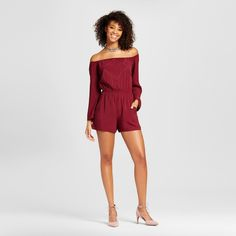 Show a little flirty shoulder in the Women's Off-the-Shoulder Romper by Xhilaration™ (Juniors'). There's a luxe look to this soft juniors' long-sleeve jumpsuit that borders on elegant.<br><br>Used to Women's sizes? Size up in Junior's or check the size chart to determine best fit.