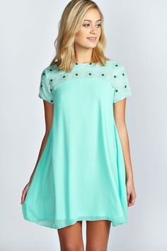 Love everything about this dress...the color, the style.  Cute.  Talia Flower Sequin Panel Chiffon Swing Dress is on sale now for - 25 % !