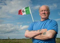 Michael Forbes poses for a photograph beside the Mexican flag he erected alongside Donald Trump's International Golf Links course, north of Aberdeen on the East coast of Scotland, on June 21, 2016..Trump is heading to Scotland to relaunch his Turnberry golf course and hotel in southwest Scotland following a £200 million ($300 million, 260 million euro) revamp of the resort, and the property tycoon will also visit his Balmedie course. Another Mexican flag is being flown at the nearby home of…