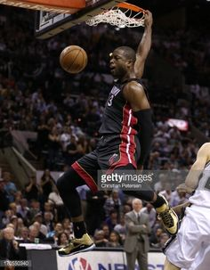 Dwyane Wade of the Miami Heat dunks the ball in front of Manu Ginobili of the San Antonio Spurs in the fourth quarter during Game Four of the 2013 NBA Finals at the AT&T Center on June 13, 2013 in...