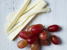 Grapes and Cheese | Though it may seem counterintuitive, you actually need snacks to lose weight. Smart snacks allow you to eat more and still lose weight, because snacks between meals keeps your body fueled. This ensures that your metabolism stays up, which actually helps you burn fat. But what you eat matters. These nutritionist-recommended snacks will help you ward off sweet temptations and avoid overeating during mealtime. Plus, they're packed with nutrients and delicious flavors that…