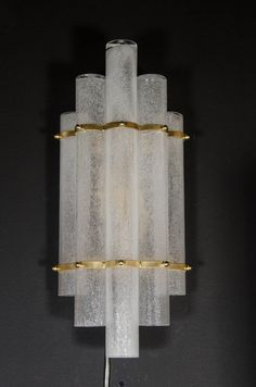 Sophisticated Pair of Mid-Century Modernist Pulegoso Glass Tubular Sconces | From a unique collection of antique and modern wall lights and sconces at https://www.1stdibs.com/furniture/lighting/sconces-wall-lights/