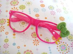 Hello Kitty pink and green glasses