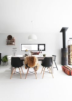 dining area with a big table and black eames chairs