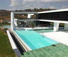 If It's Hip, It's Here: Huge Modern Athens Home With A Squash Court, Gym and Three Swimming Pools.