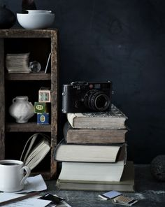 warm drink, camera, books and old photo films. mmm