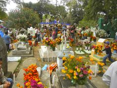 Dia de los Muertos cemetery observance in Ocotepec, Cuernavaca, Mexico.  On November 1, the graves are decorated and people gather to remember deceased children.