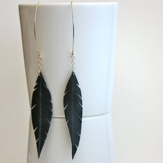 Feather earrings made of recycled bike tires. Love birds AND the environment! $20 at http://www.etsy.com/listing/78515949/plume-i-up-cycled-bike-earrings-made?ref=fp_ph_10=favitm