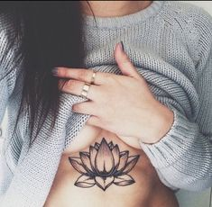 Lotus flower tattoo under breast