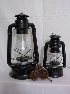 Here are a couple of lantern lamps. The big 'Dietz Blizzard' next to a little 'Dietz Purchase these custom electric lantern lamps on Etsy - Big Rock Lanterns. Lantern Lighting, Cabin Lighting, Lantern Lamp, Lanterns, Cabin Decorating, Decorating Ideas, Electric Lantern, Wagon Wheel Chandelier, Wall Fixtures