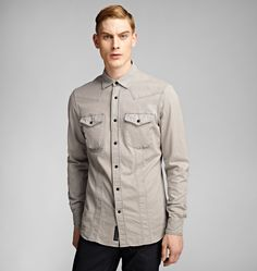 <p>With chest pockets that hint at the volume of the iconic bellows pocket, this denim shirt subtly identifies with moto heritage, and in a nod to the retro racing culture that informs Belstaff design, it holds a deliberate vintage quality. </p><br/><p>• Popper fastening</p><p>• Two chest pockets</p><p>• Tonal panel detail at shoulders and front</p><p>• Logo patch to interior placket</p><p>• Italian sizing</p><p>• Fitted through the body</p><p>• This garment fits true to size, take your…