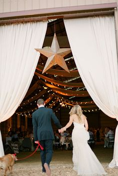 """Brides.com: . The reception was held inside the ranch's horse arena. The star that hung above the arena's entrance was a flea market find. """"My mom loves antique shopping, and spent the year before the wedding searching for items that would fit in with the décor,"""" says Jessica."""
