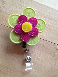 Large Flower ID Badge Holder With Retractable Reel - Made From Flip Off Vial Caps - yellow, black, purple, yellow, floral