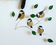 Chickadee foursome group stained glass suncatcher , birds on a 3 dimentional wire branch adorned with green glass leaves.